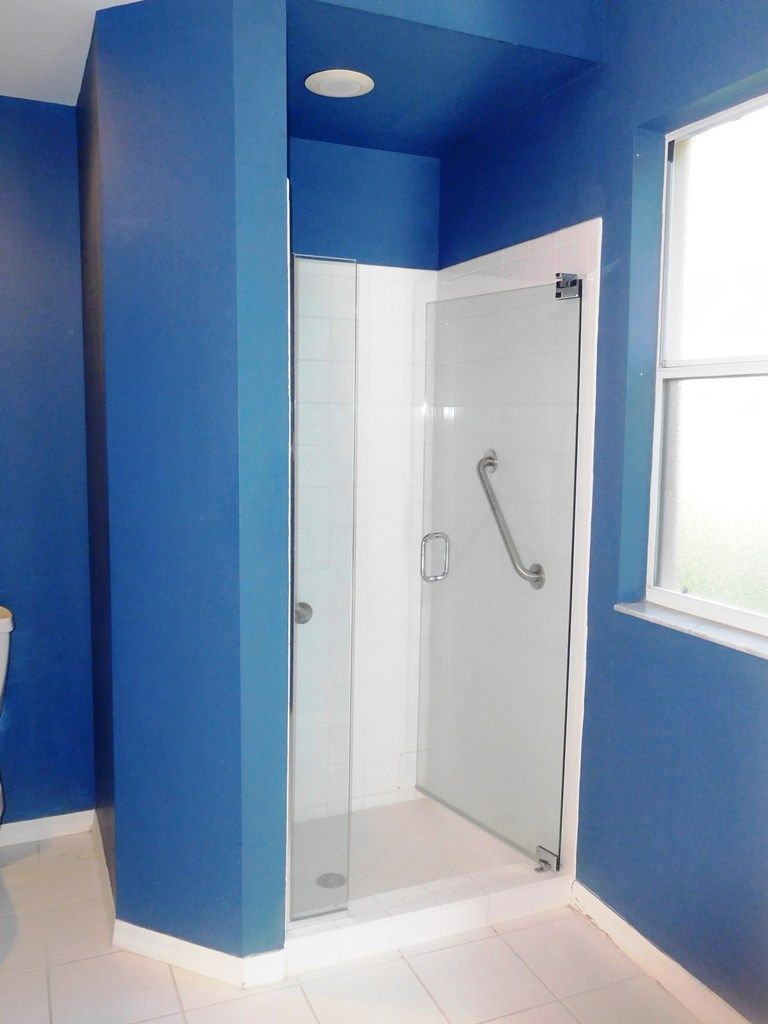 Master bathroom with dual sinks & glass shower at 526 Lake Louise ...