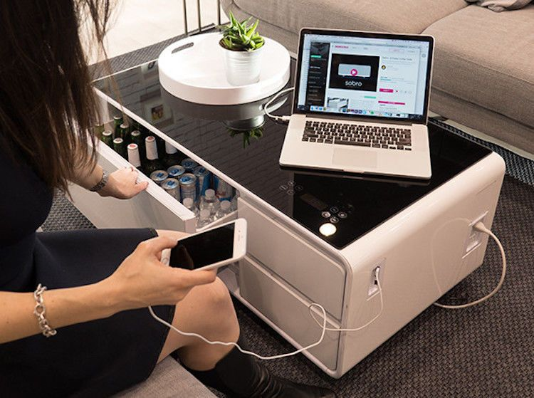 A Futuristic Coffee Table That Can Charge Your Phone And Store