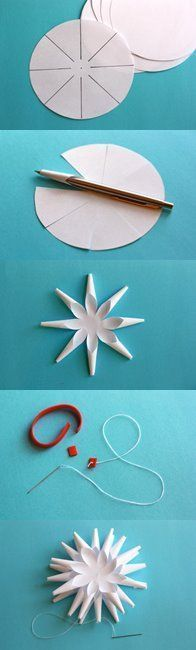 A quilled flower set in the middle of this would make a pretty ornament!! Just thread a cord through one of the inside of the tubes and pull it through the top, for a hanger. I would make single layers, if I were making an ornament.