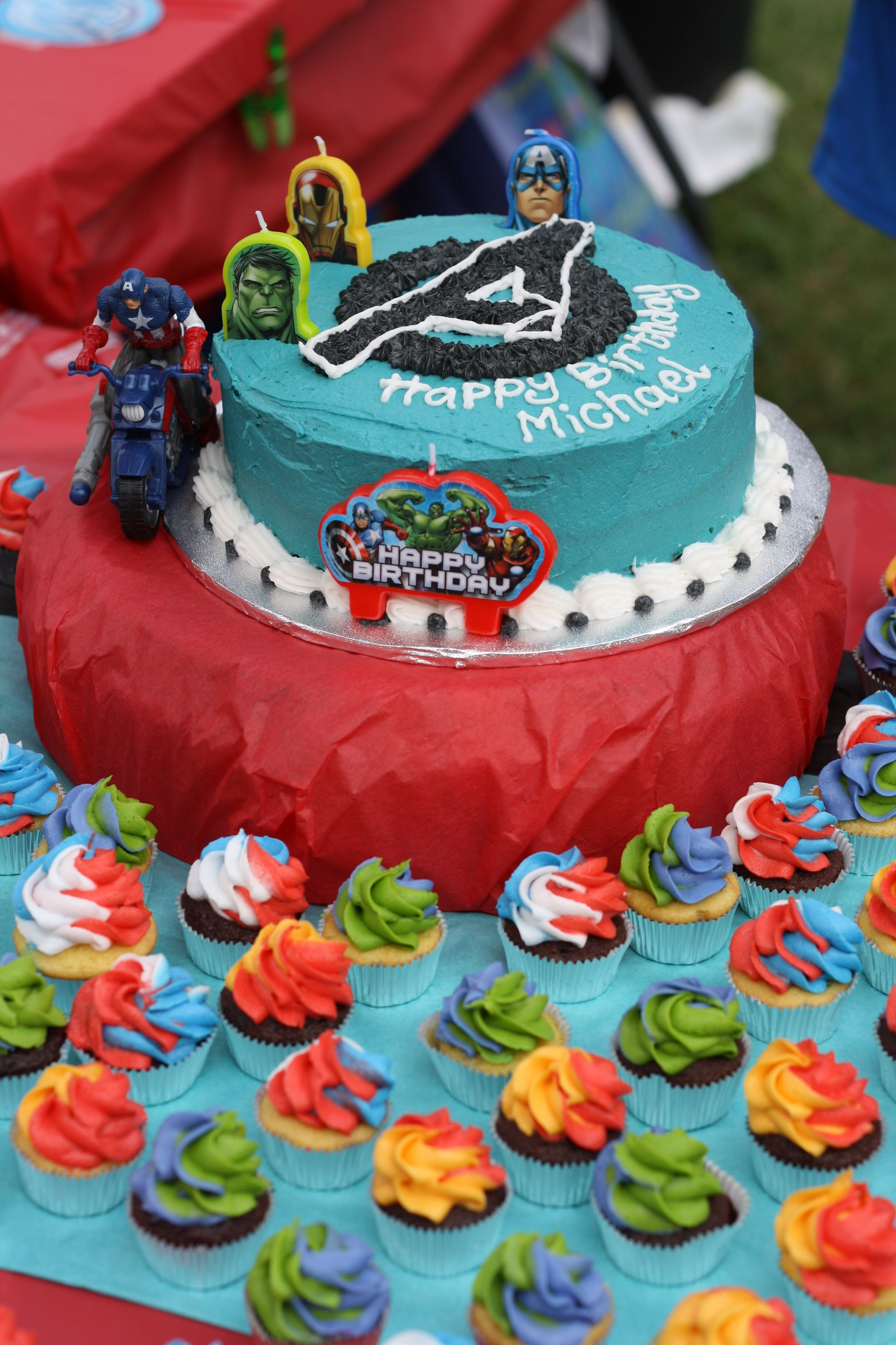 Avengers Cake with matching mini cupcakes httpswwwfacebook