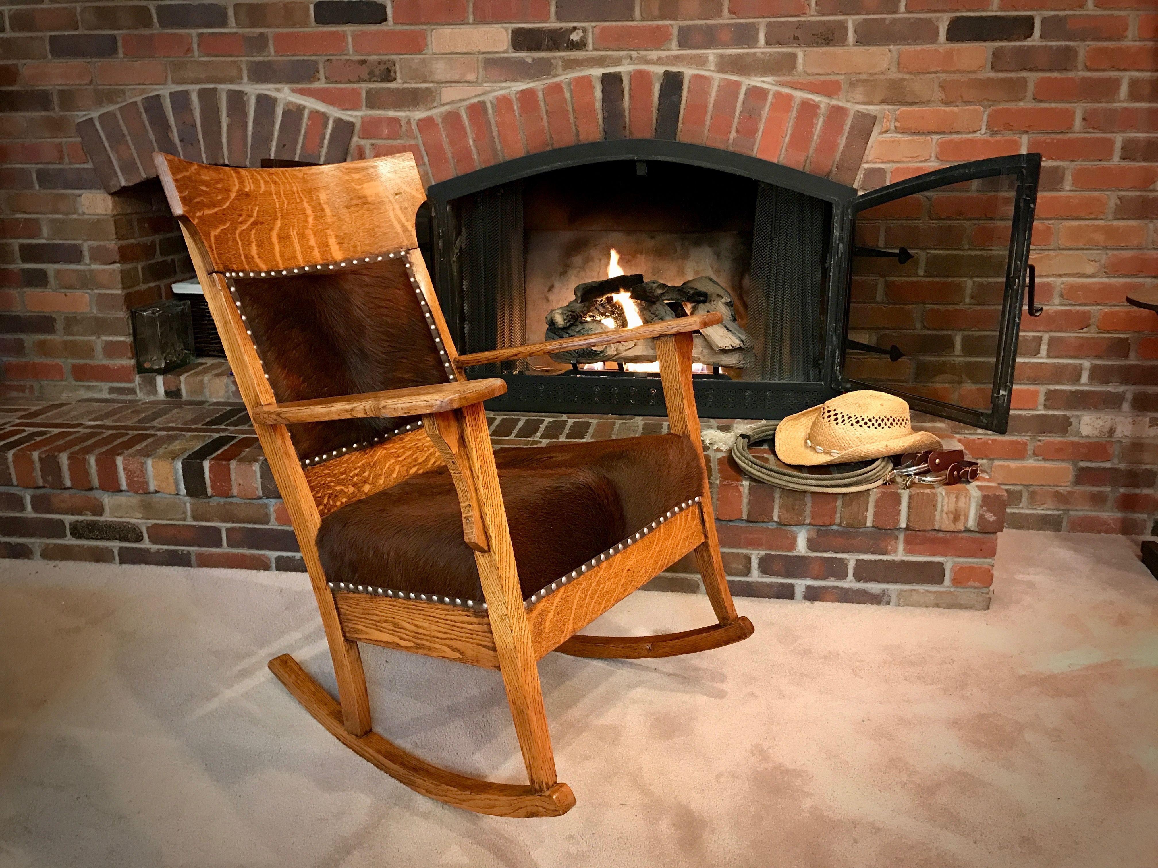 Rockin Mountain Hides Rocking Chair With A Western Flair And Covered With Awesome Cowhides Rocking Chair Antique Rocking Chairs Chair