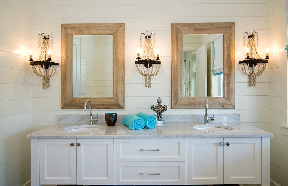 Bathroom With Wood Framed Mirrors And Shell Sconce
