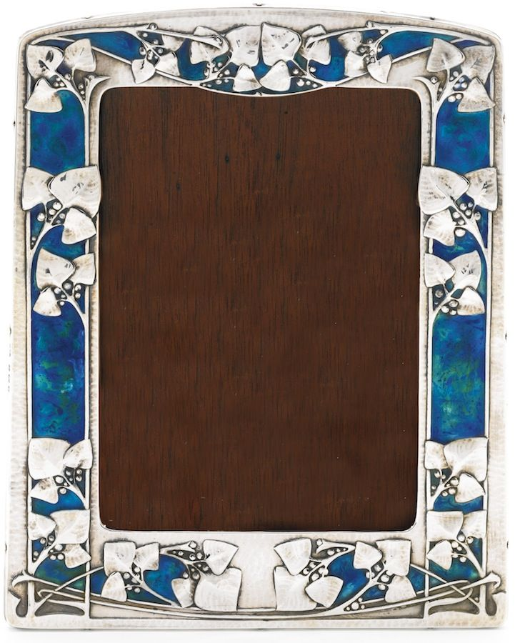 An Art Nouveau silver and enamel frame, Archibald Knox for Liberty & Co, Birmingham, 1910  |  SOLD 25,000 GBP, London 2013
