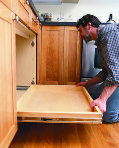 Make the most of your kitchen's existing storage space by installing a pull-out shelf in one - or all - of the base cabinets. The shelf resembles a shallow drawer that glides out for easy access to items stored in the back of the cabinet. #diy #howto #kitchenstorage #kitchenideas #homeimprovement #kitchenupgrades #kitchen #storage