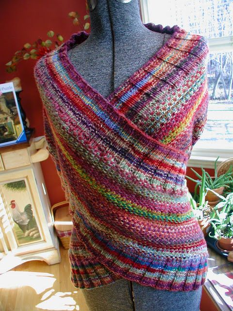 Fiddlesticks - My crochet and knitting ramblings.: Laura's Wrap no pattern, but it's just basically a wider, longer scarf with buttons and you can wear it different ways.