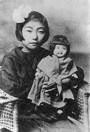 "Japanese girl with doll, probably one of the ""blue-eyed dolls"" given to Japan in 1927 as part of the Friendship Doll program. In WWII, most were burned in front of children, stabbed, spared and otherwise destroyed on Japanese government orders."