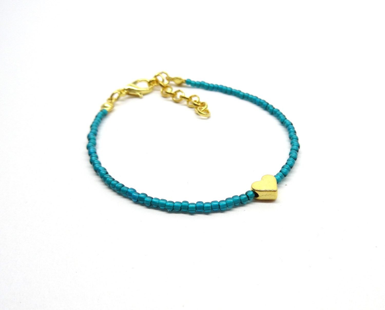 Dainty bracelet,delicate bracelet ,seed beads bracelet,thin bracelet, minimalist bracelet ,boho chic bracelet,heart bracelet ,tiny bracelet door HipLikeMe op Etsy https://www.etsy.com/nl/listing/263285959/dainty-braceletdelicate-bracelet-seed
