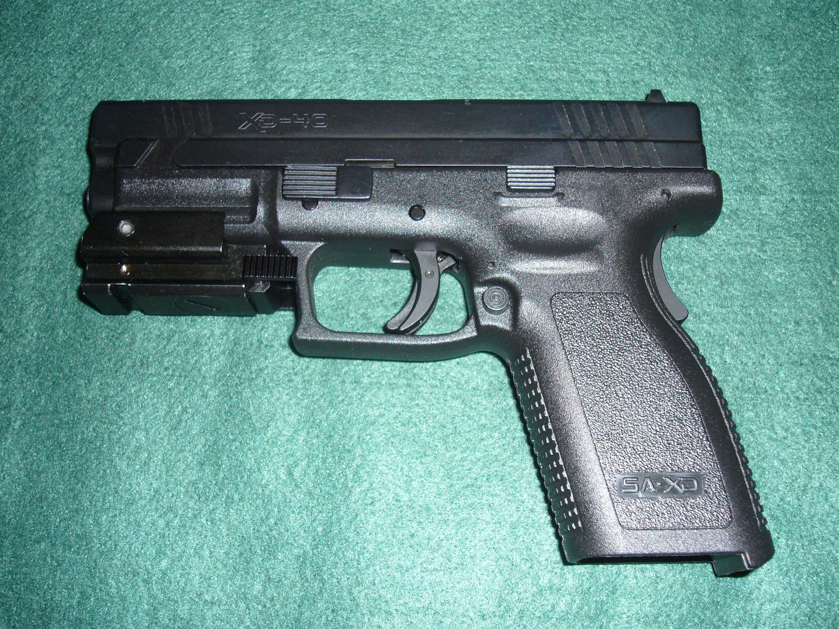 Springfield XD 40 Caliber With Laser A few My Guns