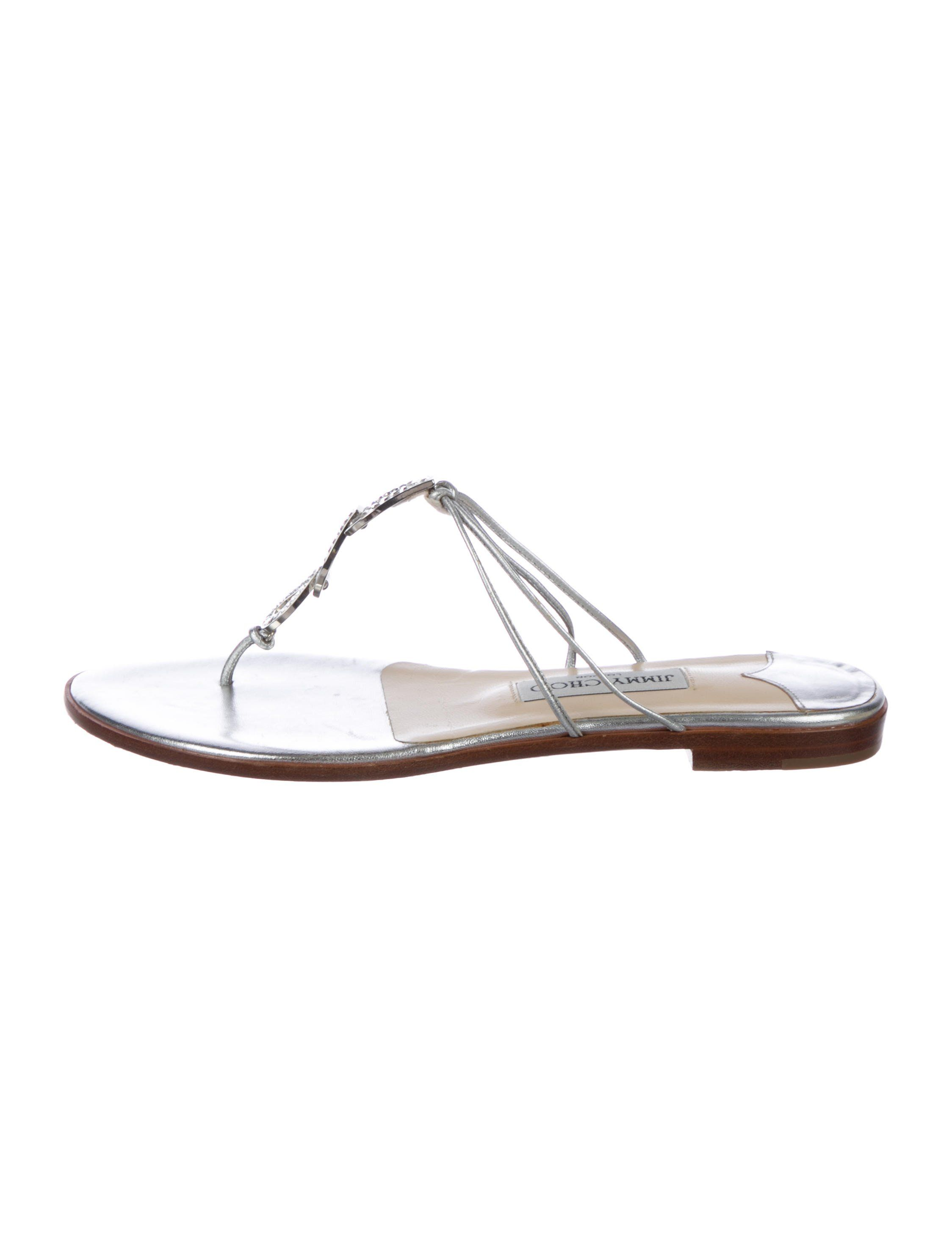 2e1a8ac67 Silver leather Jimmy Choo thong sandals with crystal embellishments at vamps  and stacked heels.