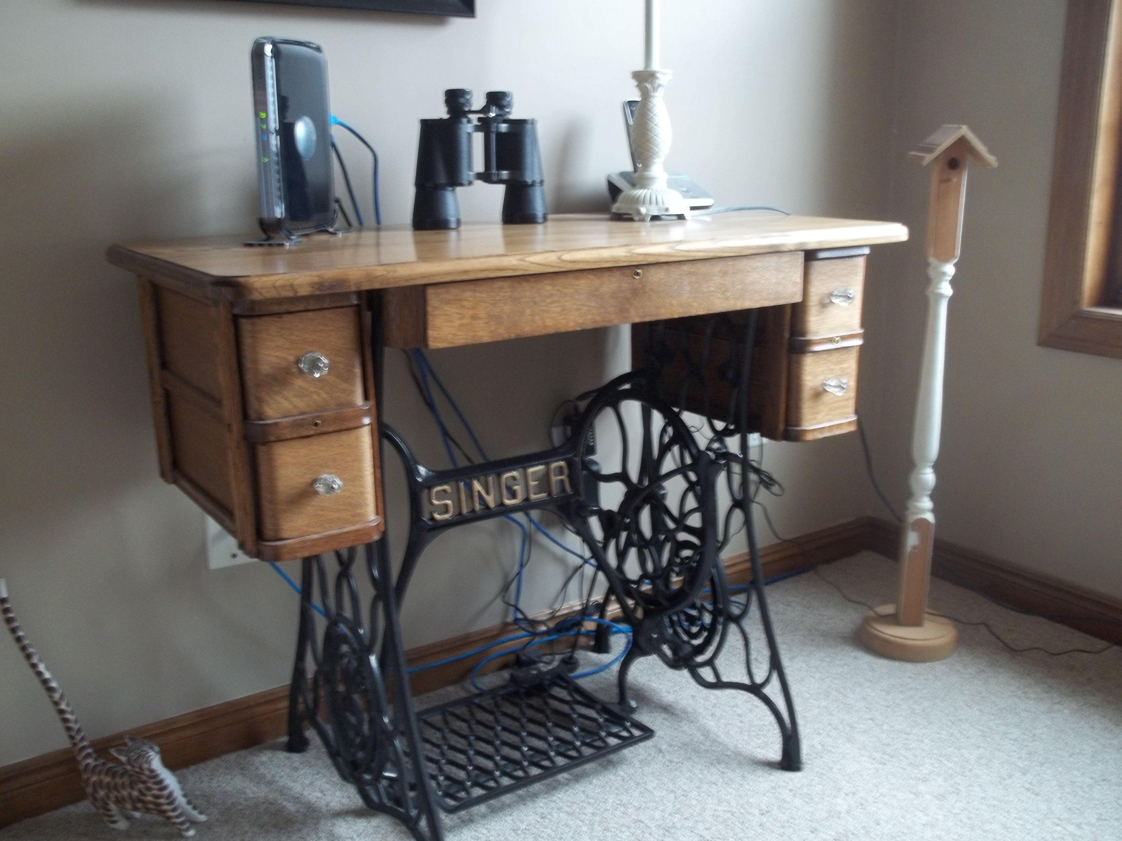 Old singer sewing cabinet made into decorative display table ...