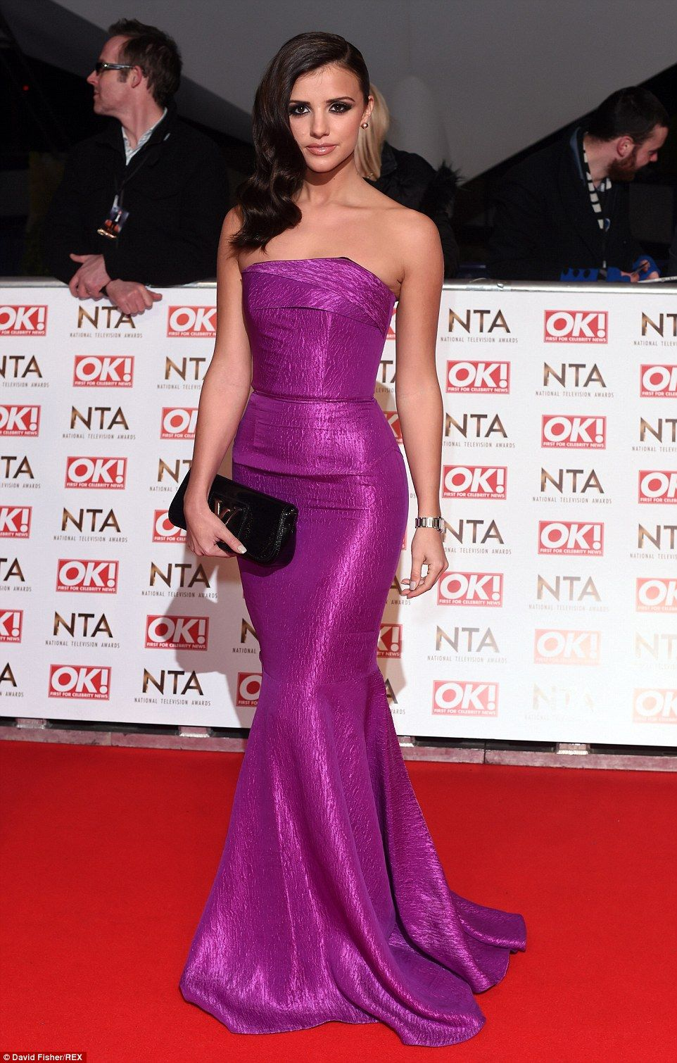 d4e363baa56 Purple perfection  Former TOWIE star Lucy Mecklenburgh cut a classy figure  in her straples purple dress which she accesorised with a black Louis  Vuitton ...