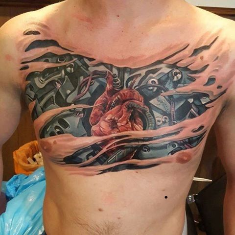 New School Style Colored Chest Tattoo Of Biomechanical Heart Tattoos Chest Tattoo Biomechanical Tattoo
