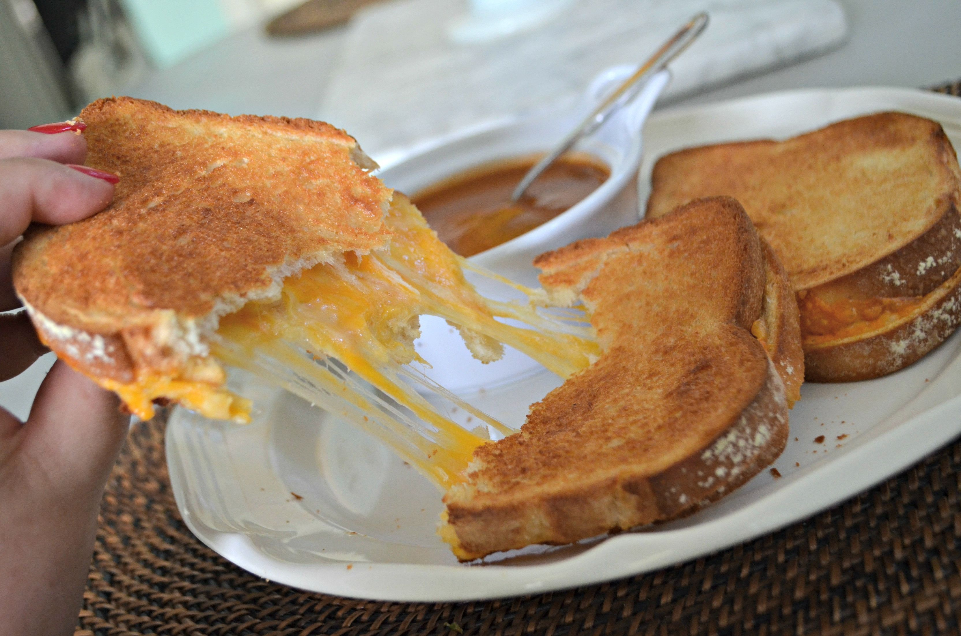 air fryer grilled cheese pulled apart on a plate Air