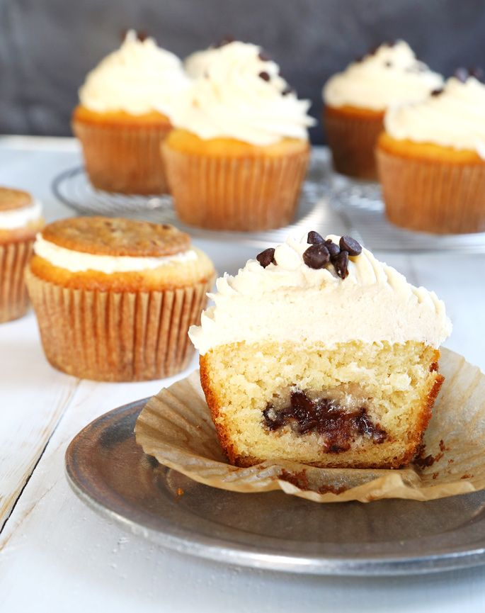 Get this tested, easy-to-follow recipe for gluten free cookie dough cupcakes—moist yellow cakes stuffed with cookie dough and topped with cookie dough frosting.