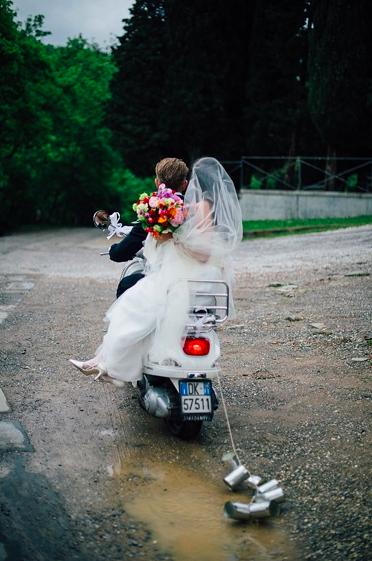 Tuscania Events couple on vintage vespa