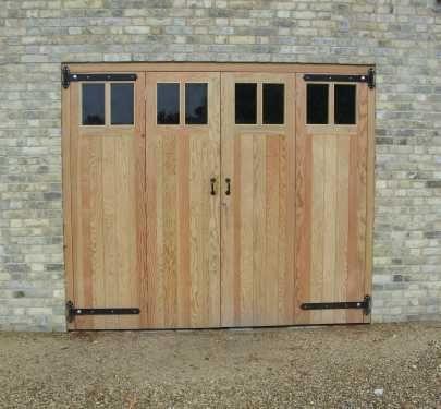 A Perfect Space Saving Solution Garage Door Design Garage Doors Timber Garage
