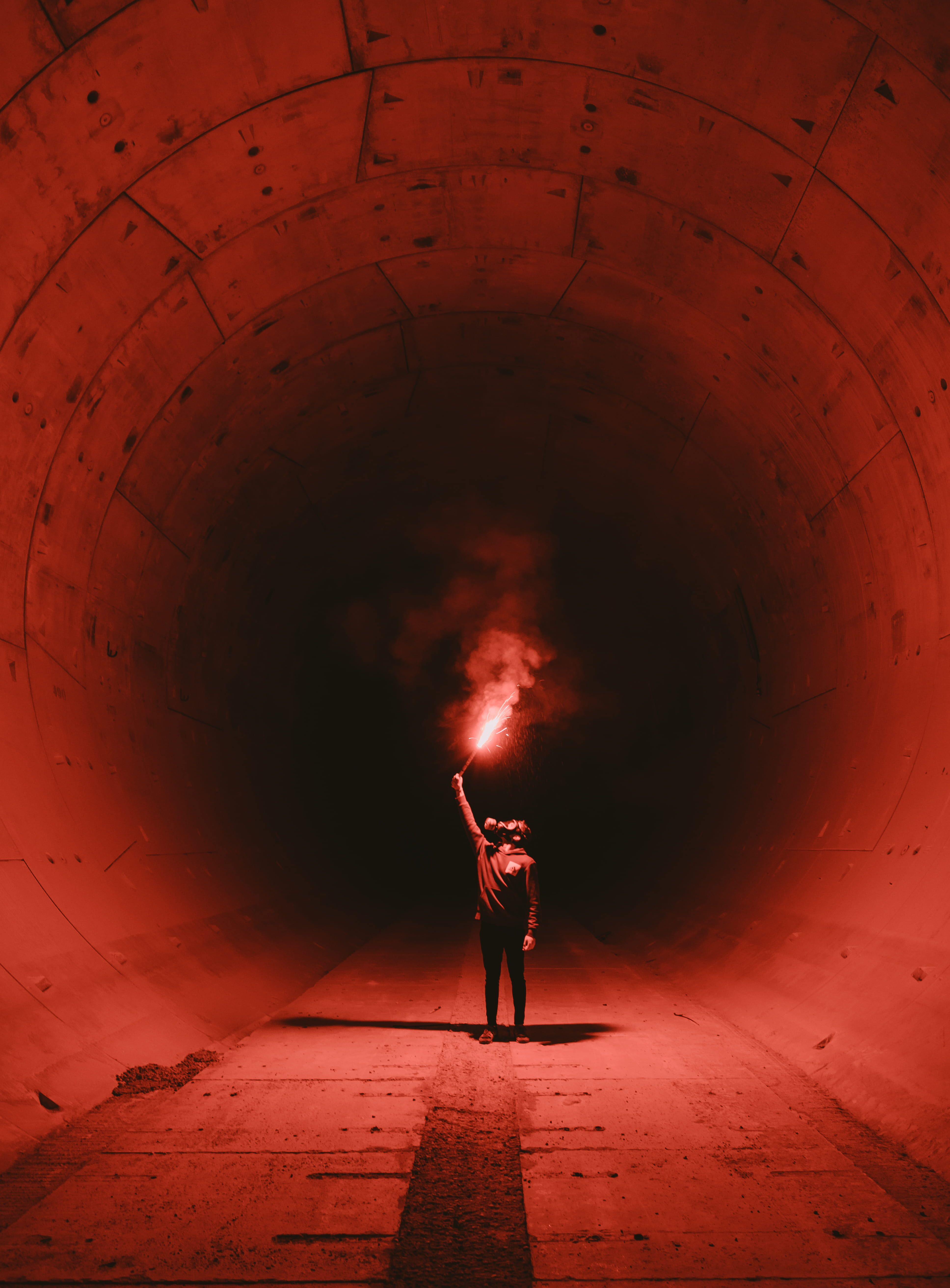 Man Wearing Gas Mask Holding Torch Inside Tunnel Human In The Tunnel Holding Red Light Smoke Tunnel Person Smoke Tunnel Photography Photo Dark Photography