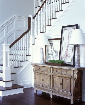 entrance way, love the double lamps and leaning prints