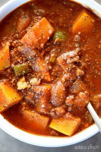 Butternut Squash Chili Recipe - Butternut Squash Chili recipe made with ground beef or turkey, butternut squash, vegetables, and spices makes a hearty and delicious chili recipe! // addapinch.com