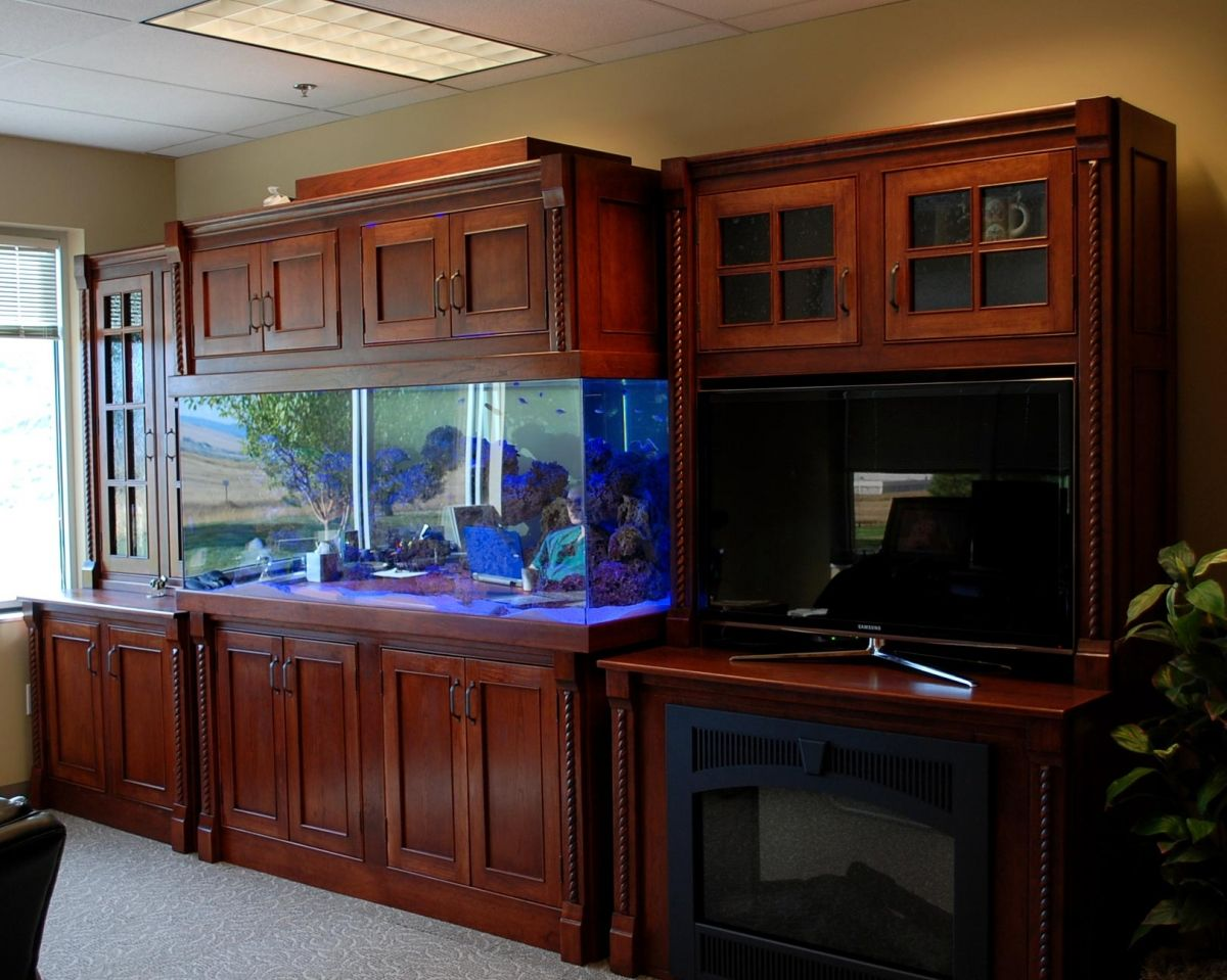 Custom Built Cherry Wood Salt Water Aquarium Also With Fireplace And Storage Built By Jim Cardon Customs Fish Tank Cabinets Fish Tank Aquarium Stand