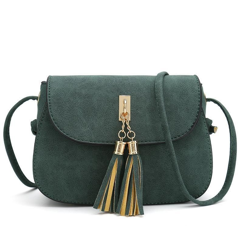 bd38292d3b50 A boxy crossbody bag in pebbled leather features a lush