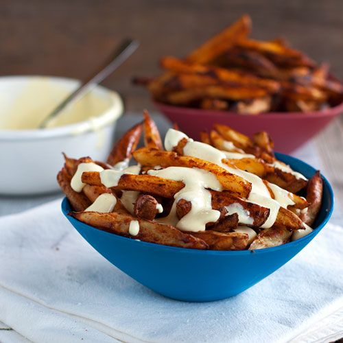 Baked Spicy Fries with Garlic Cheese Sauce. These look sooo dang good!