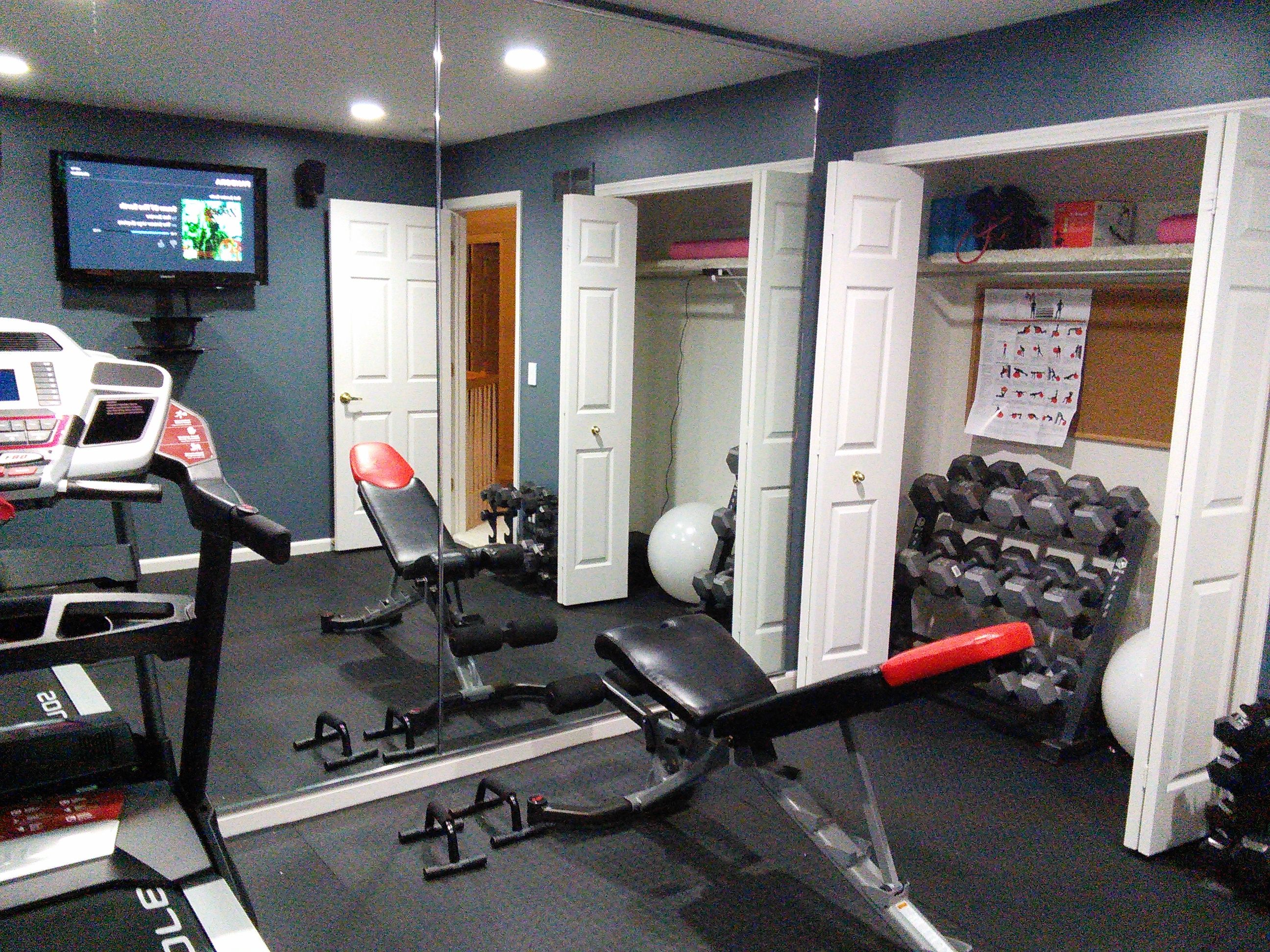 make your home gym work in a small room - movable bench, foldable  treadmill, TV/speakers off floor, dumbbells/accessories in closet, LED  recess lighting to ...