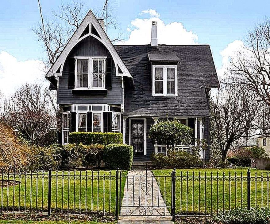 Picturesque Black Victorian House Design With Black Fence And