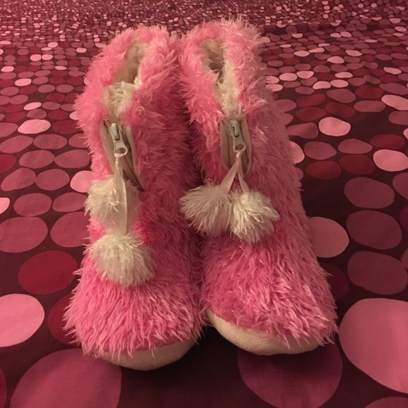 """Pink and white fuzzy slippers Dr. Scholl's fuzzy slippers. These are super cute and comfy! They have a front zip closure with two """"snowballs"""" tied onto the zipper. Inside of slipper has white fuzzy material and outside is pink. These are size medium(7-8). Dr. Scholl's Shoes Slippers"""