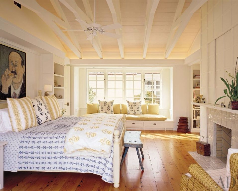 Cottage Master Bedroom With Ceiling Fan Exposed Beam Built In Bookshelf Tiles Fireplace