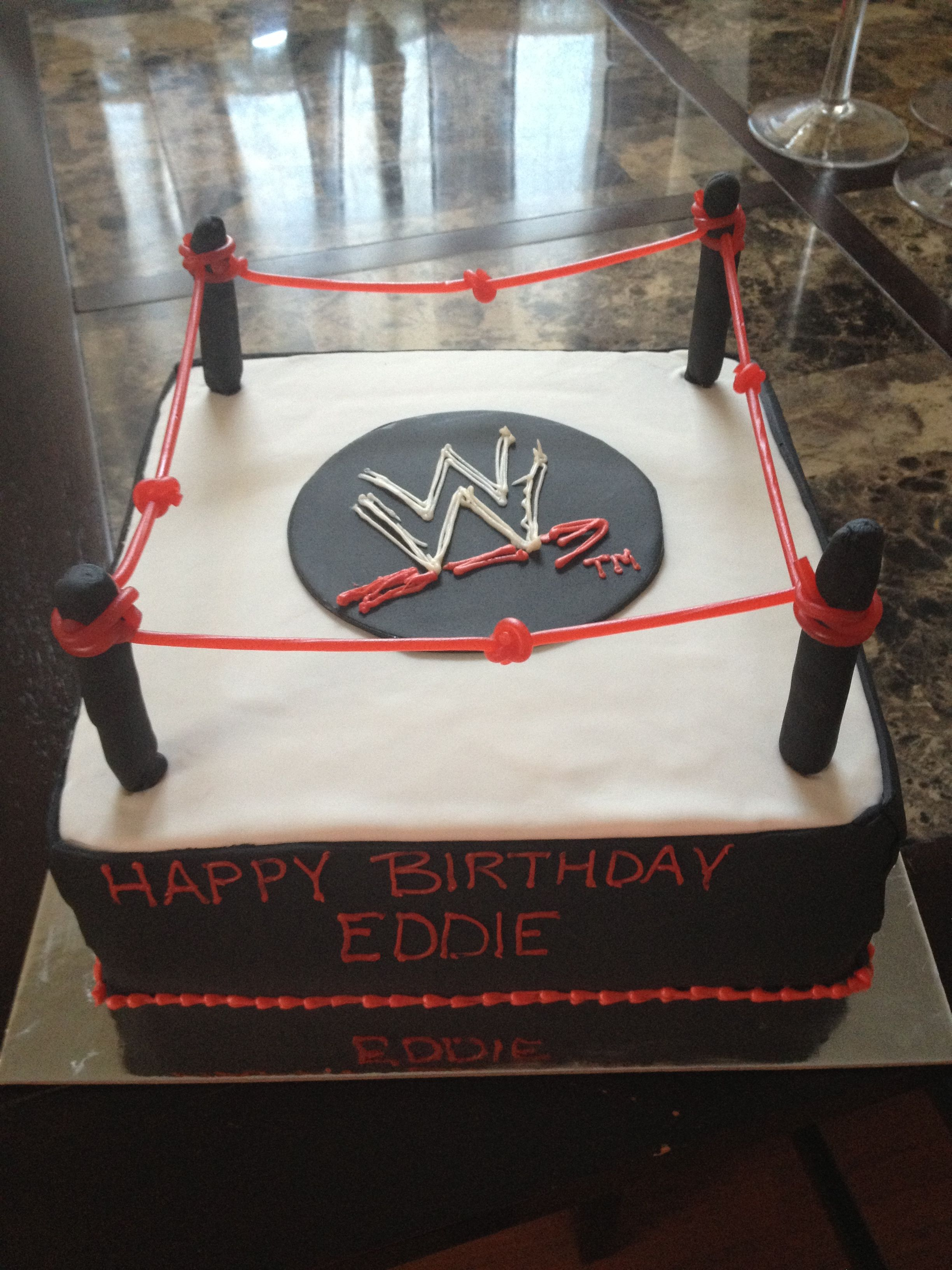 wwe wrestling ring cake logo in the center jakes 7th