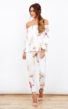 This beautiful floral two piece is a must have summer dress outfit. The off the shoulder style makes it perfect for dressing up or down. Looks gorgeous paired with sandals or heels. Shop Now.