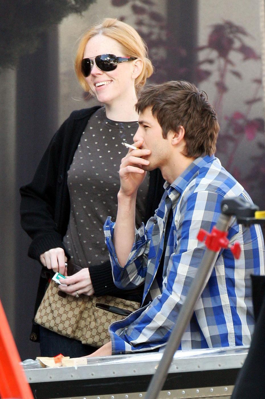 Ashton Kutcher smoking a cigarette (or weed)