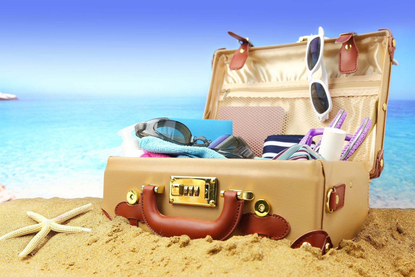 AnnetteJonesBiz Full open suitcase on tropical beach background ...