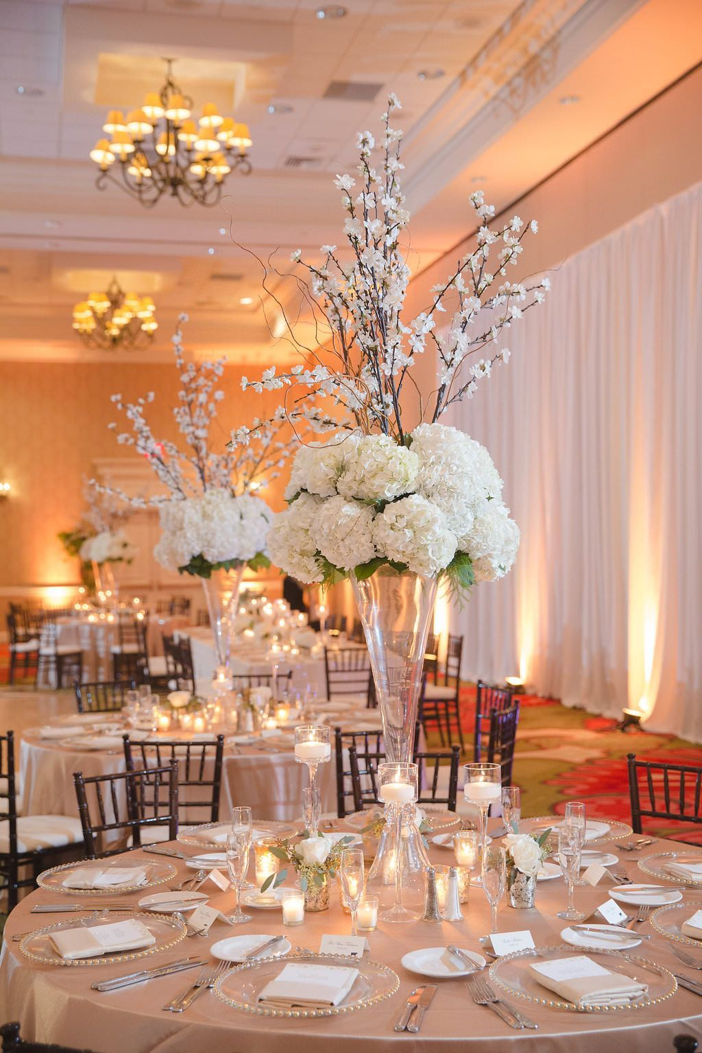 Hotel Ballroom Gold And White Wedding Reception Round Table Decor With Tall White Wedding Reception Table Decorations Flower Centerpieces Wedding Wedding Table
