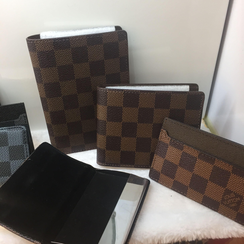 50ac7b0720f Discover ideas about Lv Men. January 2019. Louis Vuitton Lv man short  wallet 2 folds money clips