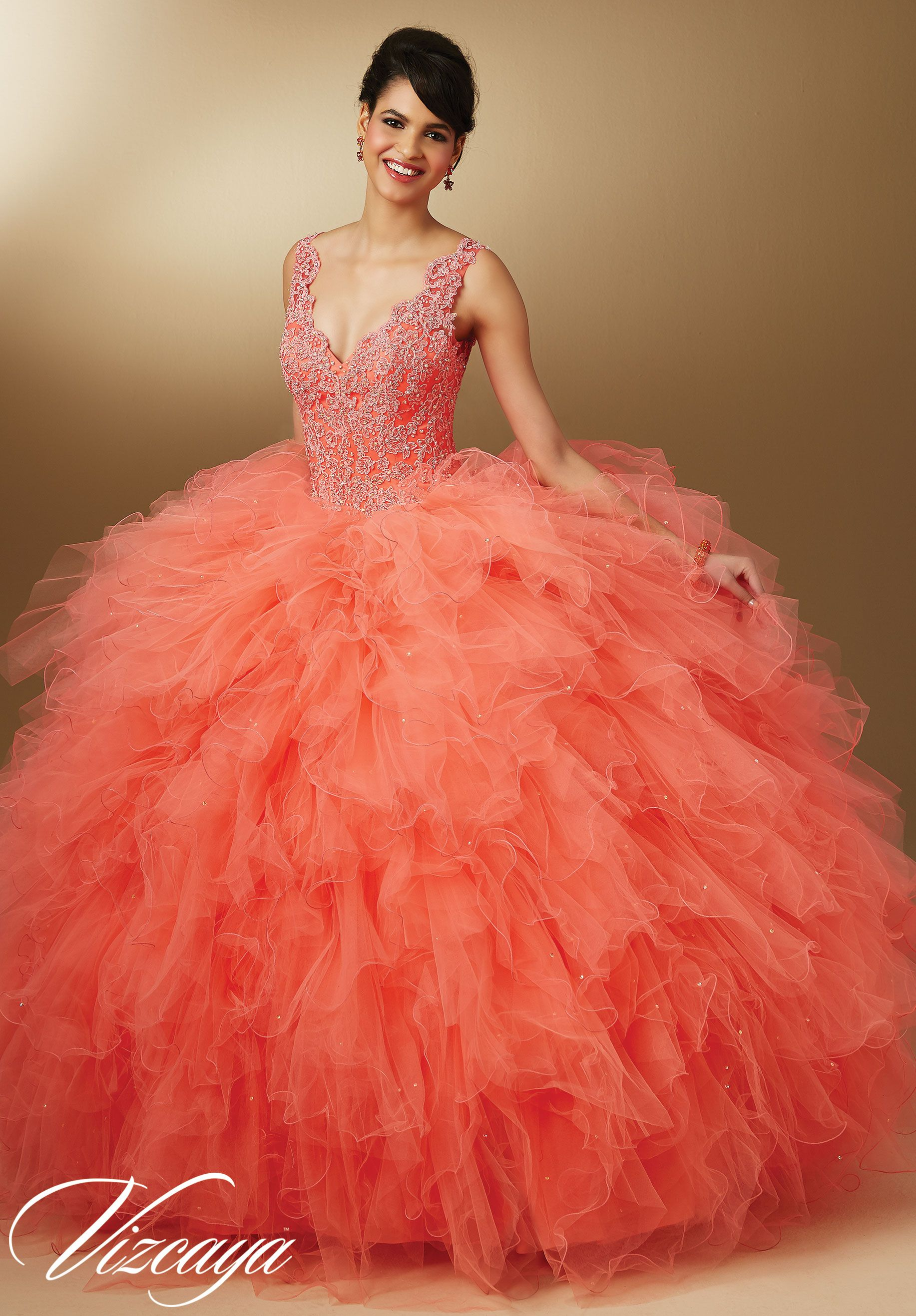 Coral Crystal Beaded Lace on Ruffled Tulle Princess Ball Gown with Straps, V Neck. Matching Stole included. Color available: Champagne, Coral, Aqua and White. Quinceanera Dress by Vizcaya Morilee Designer Madeline Gardner.
