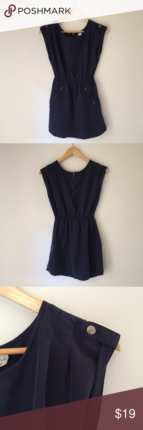 H&M fitted tunic dress H&M fitted tunic dress in navy. Zipper pockets in front, fitted waist and button detail on shoulders. Goes great with tights and boots! Size 4. H&M Dresses Mini