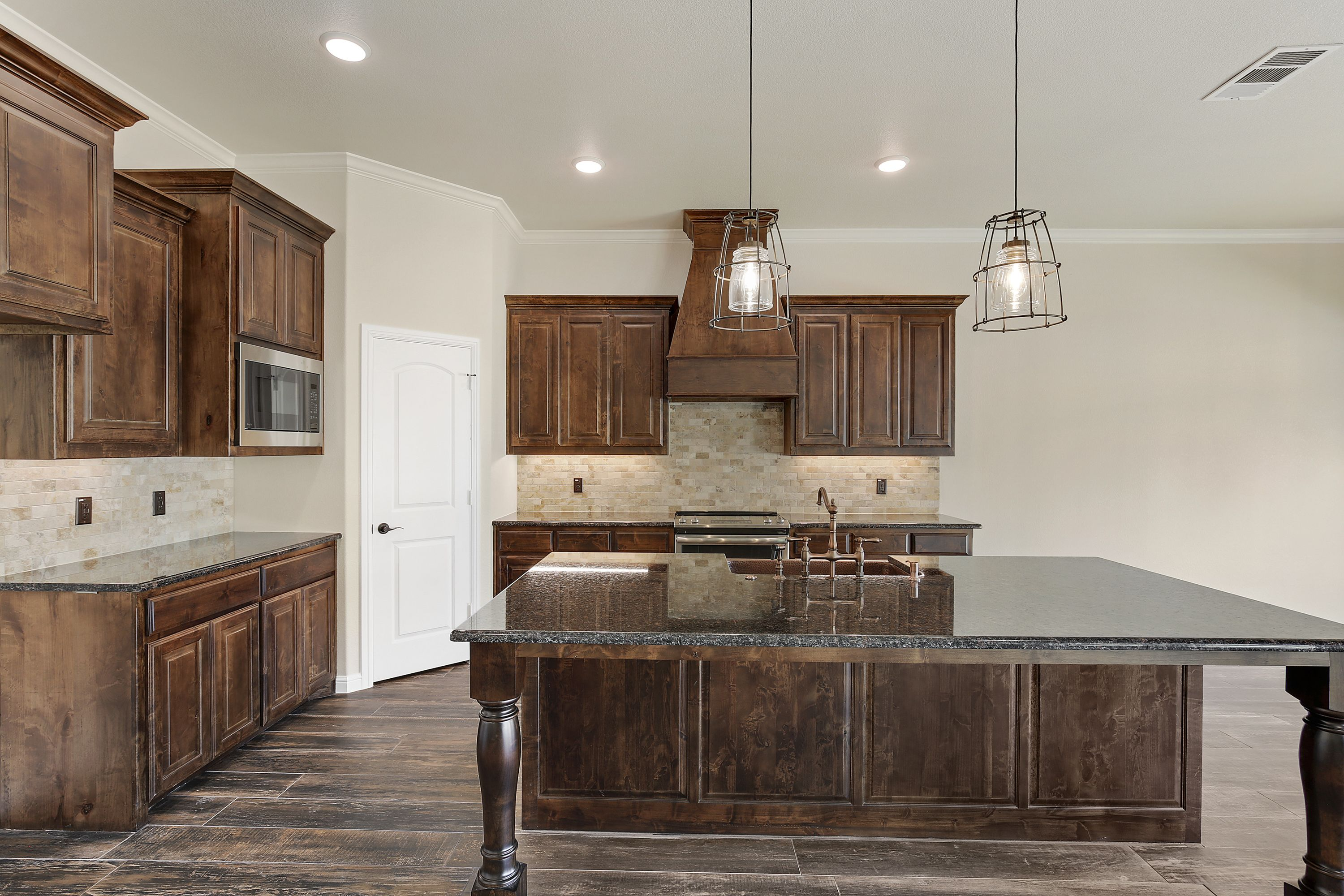 Dark Wooden Custom Kitchen Cabinets By Doug Parr Custom Homes Boyd Tx Custom Kitchen Cabinets Custom Kitchens New House Plans