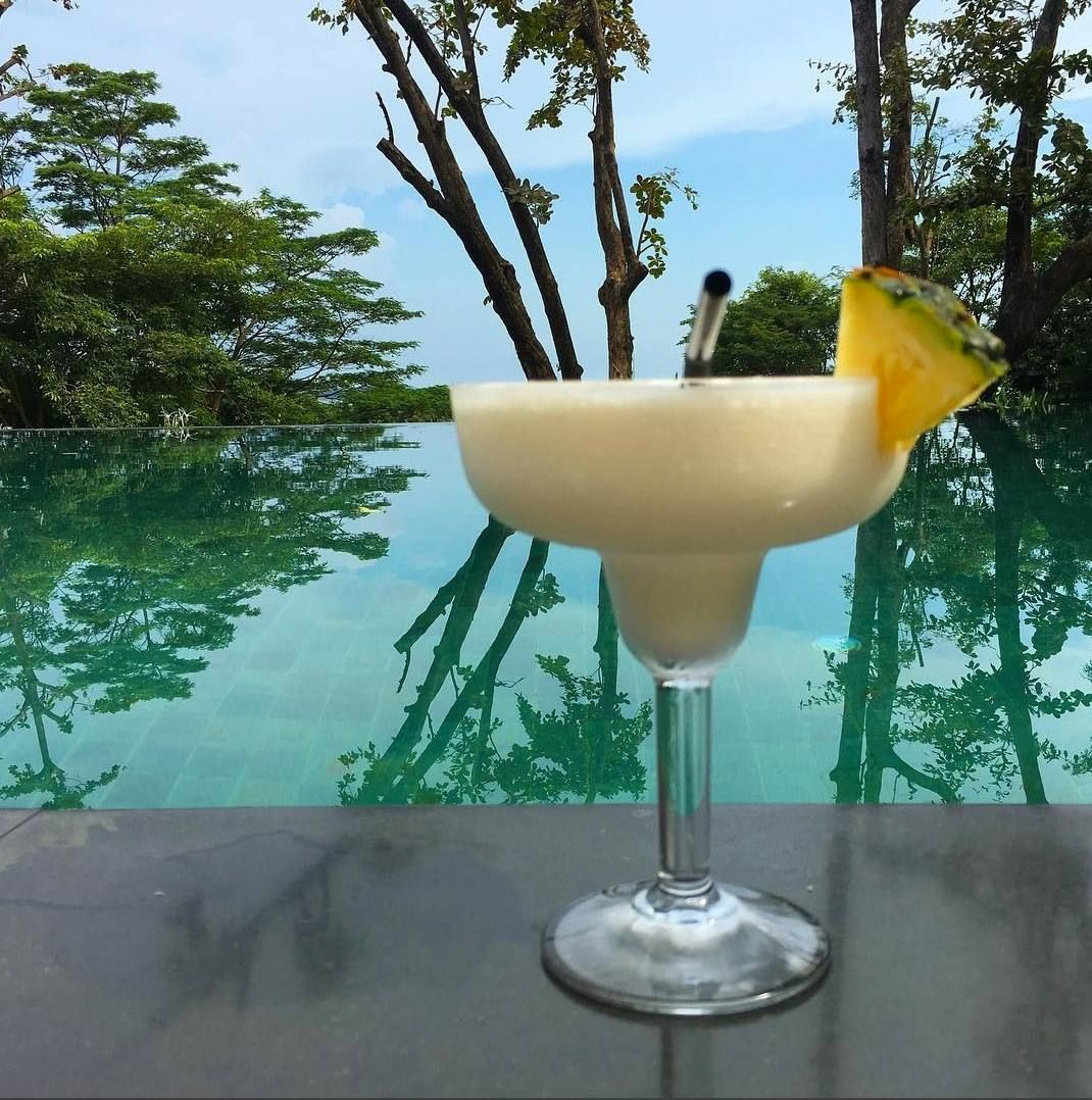 After a few piña coladas, Tuesday will feel like Friday! I love island life!   Inspiring picture by Once in a Lifetime Journey. #TrueCapella #CapellaSingapore #Luxury #Resort #Singapore #Asia #Cocktails #Bobsbar #Pool #Summer
