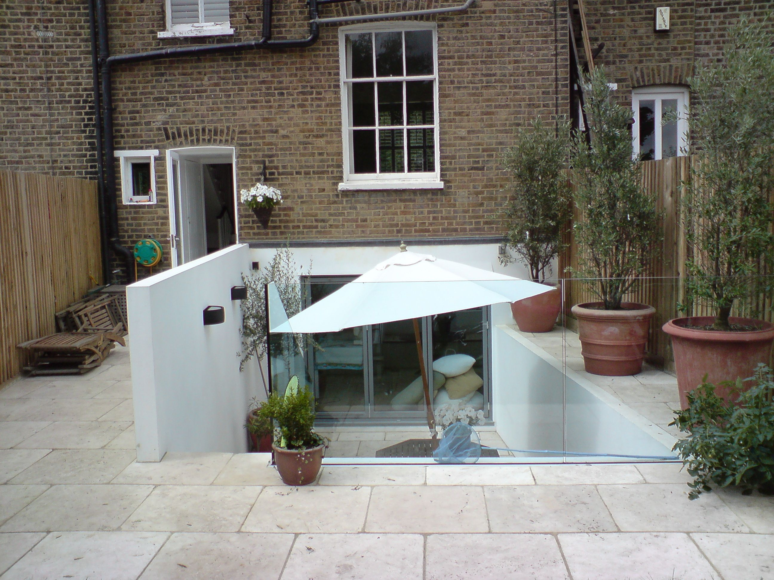 Cellar conversions and basement renovations in london and for Courtyard renovation ideas