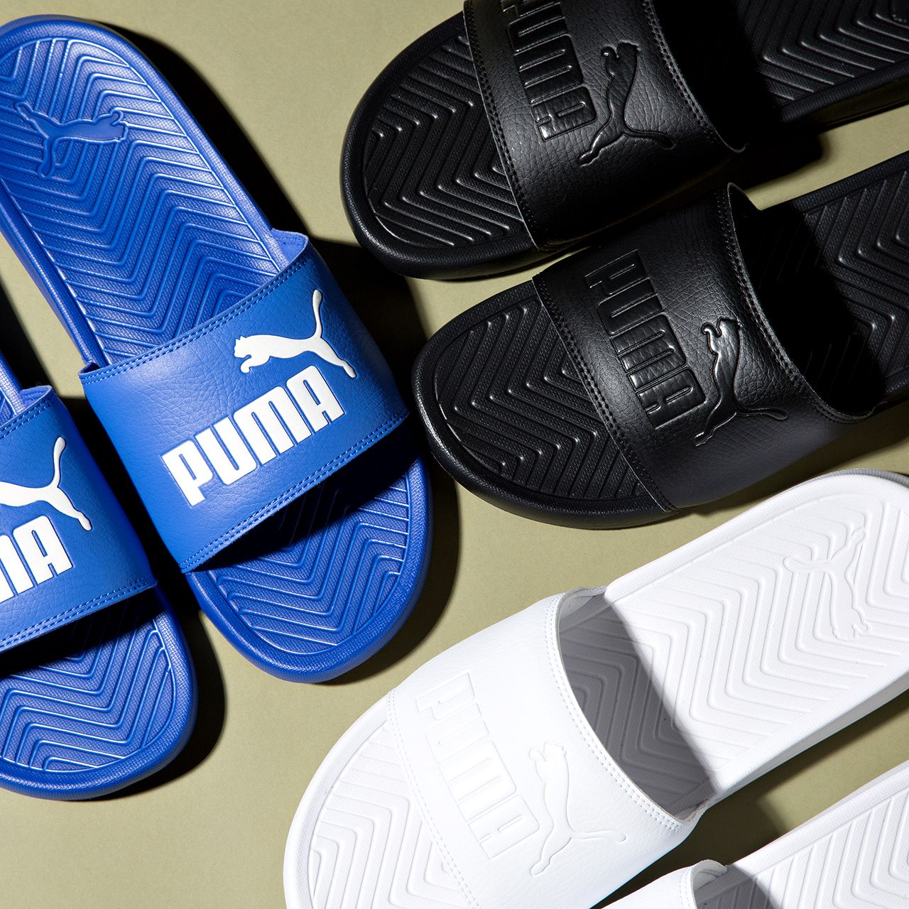 Get ready for summer with the Puma Popcat Slide Sandal.  c21163ac19
