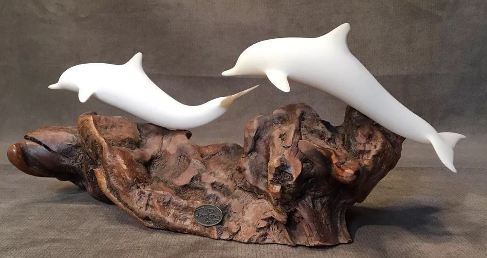 John perry sculpture a pair of dolphins on a beautiful