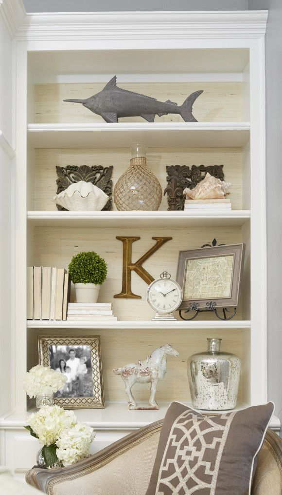 Textured, neutral wallpaper lining the back of bookcase. | For our ...
