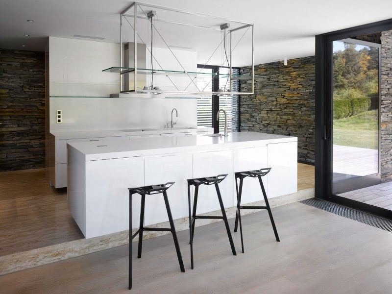 Nice Villa Ritka: Perfect Dwelling For Modern Lifestyle : Black Bar Stools White  Kitchen Island Stony Wall Wooden Floor