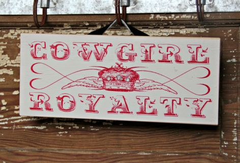 """Cowgirl Royalty with rhinestone Bling on the crown  3/4"""" American Pine, Hair on hide hanger  Measures 13"""" long x 5 1/2"""" wide  Hand made in the USA  Background colors will vary"""