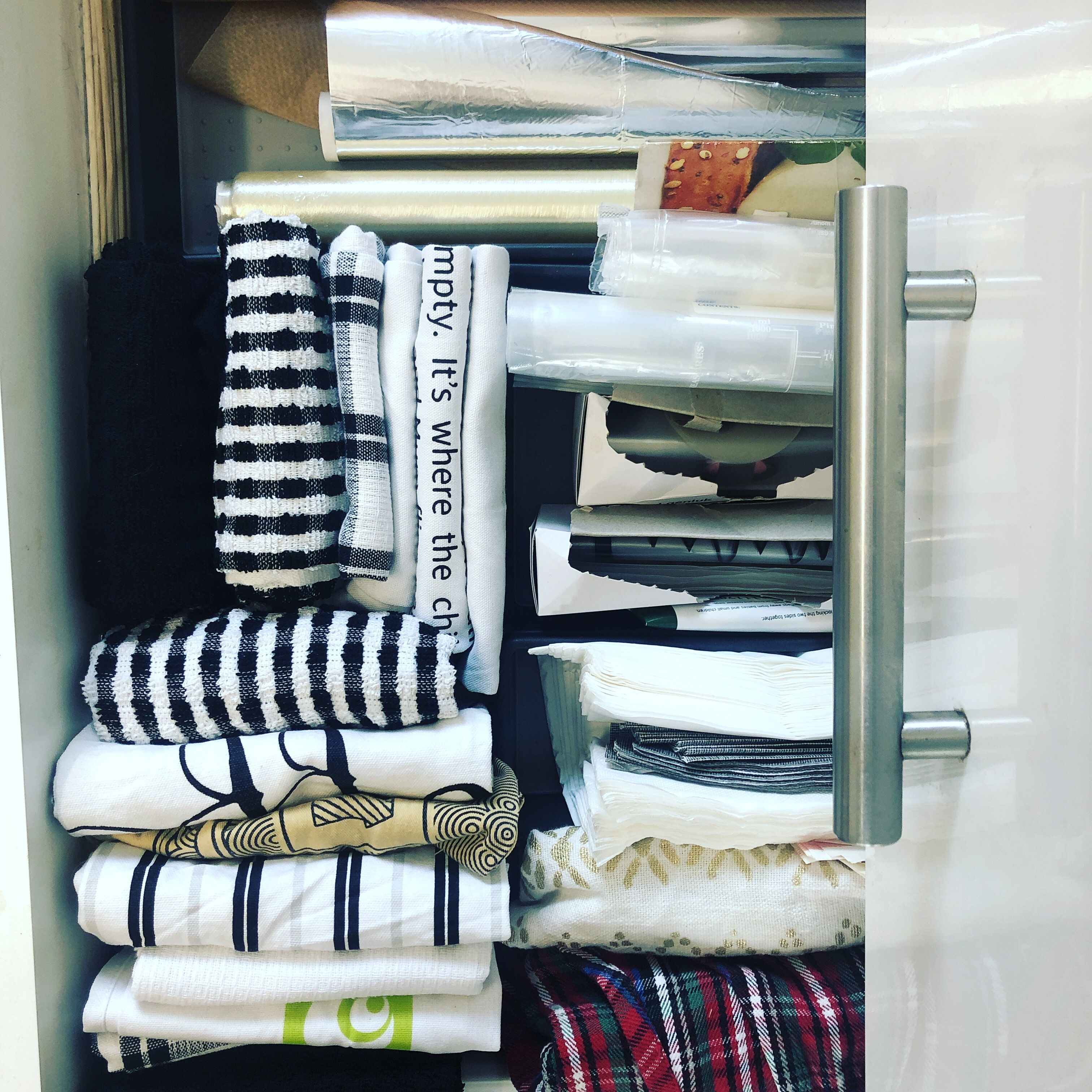 Tidy Your Kitchen Draws By Adding Draw Sorters And Folding Your