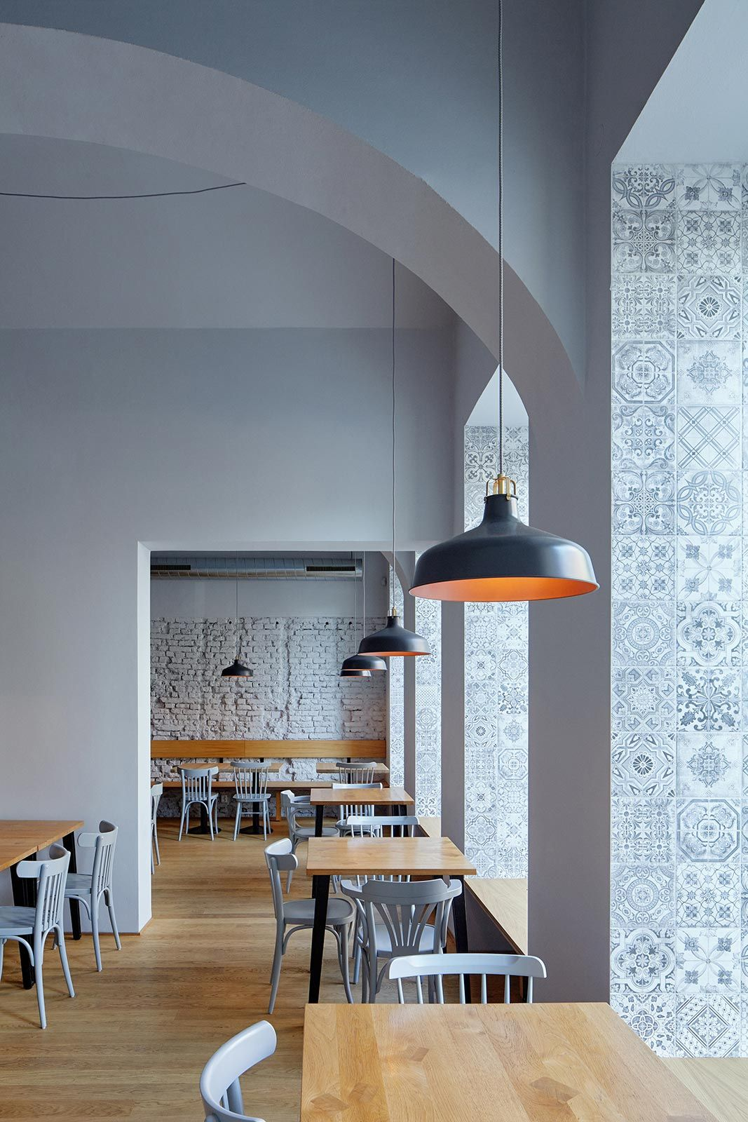 In a growing prague district of karlín which was affected by the hundred year flooding in 2002 this event is reflected in the interior of the bistro