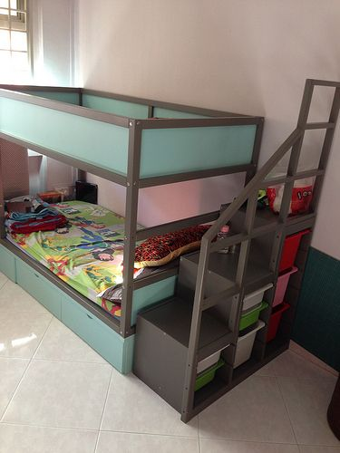 Ikea Kura bed makeover – final product. Painted the wood dark grey, panels were Tiffany blue, added storage drawers underneath with roller wheels with a platform on top, to place a mattress