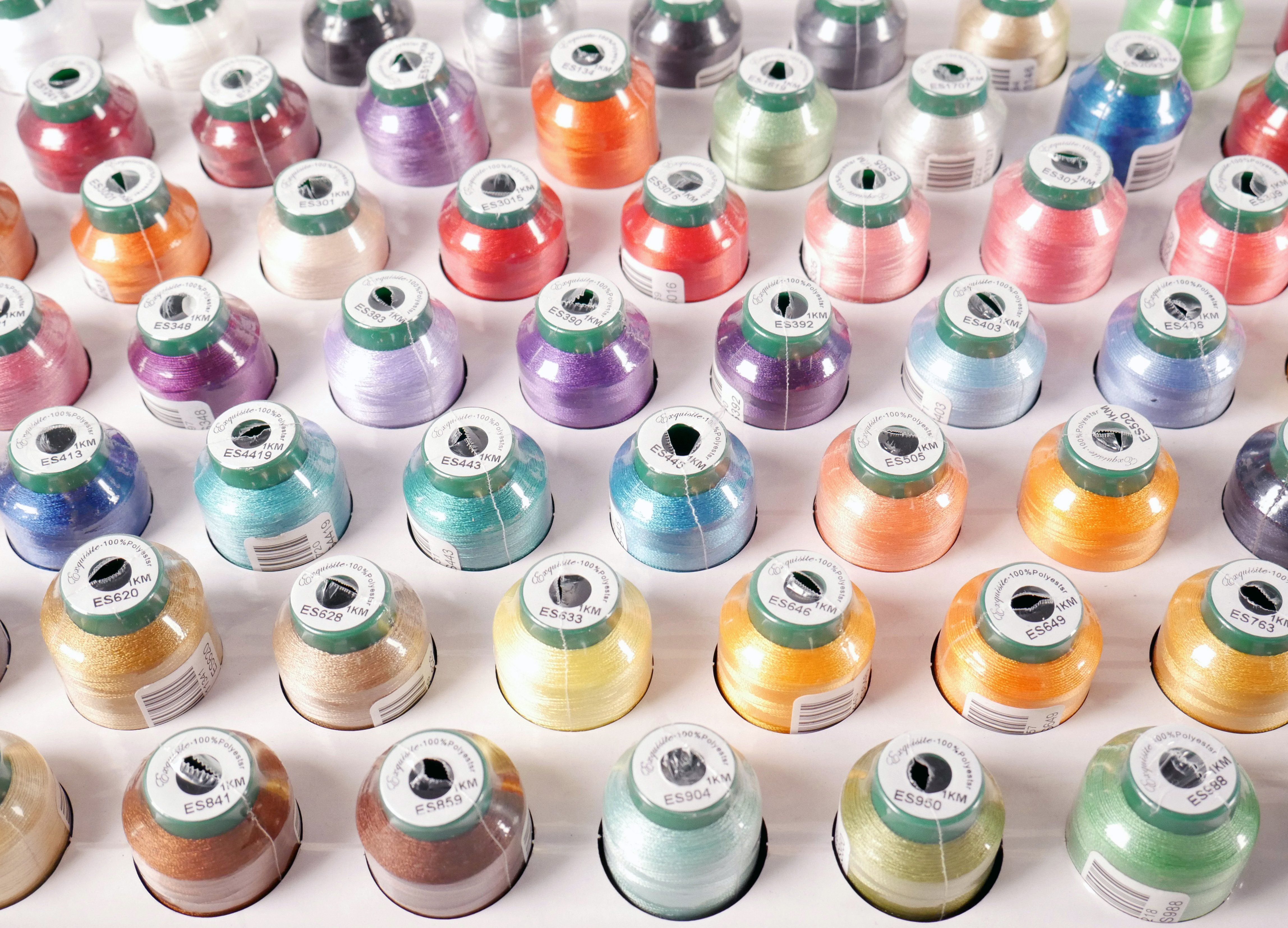 Exquisite Thread Assortment - 60pk 1000 Meter Spools 40 wt • 120/2 Denier Thread • 1000 Meter Grab this beautiful 60 pack of Exquisite 40wt 120/2 denier thread in our most popular colors. Exquisite thread is a high-quality polyester thread at a value price and provides the same brilliant sheen as rayon. The Exquisite brand of polyester threads are colorfast and withstand fading from ultraviolet rays and damage from laundering. Spools are individually shrink wrapped. Colors include: ES010, ES015,